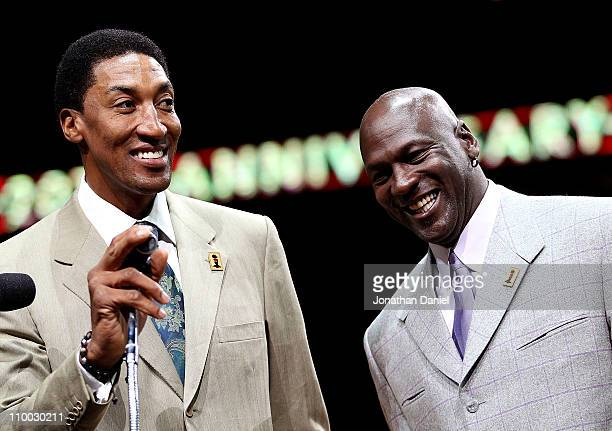 Former players Scottie Pippen and Michael Jordan of the Chicago Bulls smile as the crowd cheers during a 20th anniversary recognition ceremony of the...