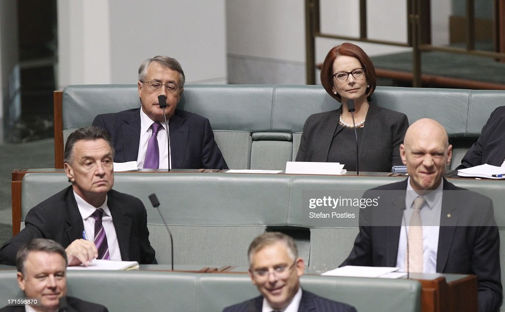 Former PM <a gi-track='captionPersonalityLinkClicked' href=/galleries/search?phrase=Julia+Gillard&family=editorial&specificpeople=787281 ng-click='$event.stopPropagation()'>Julia Gillard</a> and former ministers <a gi-track='captionPersonalityLinkClicked' href=/galleries/search?phrase=Wayne+Swan&family=editorial&specificpeople=4582809 ng-click='$event.stopPropagation()'>Wayne Swan</a> (Top L), Craig Emerson (Centre L), and Peter Garrett (R) sit on the back bench during House of Representatives question time on June 27, 2013 in Canberra, Australia. Kevin Rudd won an Australian Labor Party leadership ballot 57-45 last night, and will be sworn in this morning as Australian Prime Minister by Governor-General Quentin Bryce. Rudd was Prime Minister from 2007 to 2010 before he was dumped by his party for his deputy <a gi-track='captionPersonalityLinkClicked' href=/galleries/search?phrase=Julia+Gillard&family=editorial&specificpeople=787281 ng-click='$event.stopPropagation()'>Julia Gillard</a>. Gillard has announced that she will leave parliament and not contest her seat following her ballot loss.