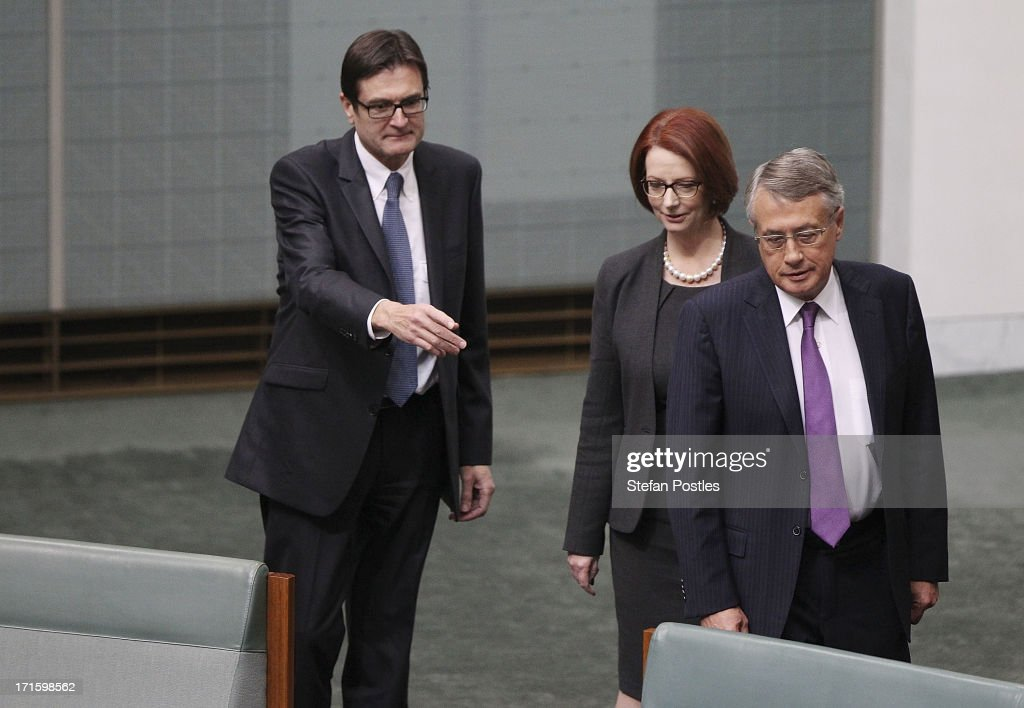 Former PM <a gi-track='captionPersonalityLinkClicked' href=/galleries/search?phrase=Julia+Gillard&family=editorial&specificpeople=787281 ng-click='$event.stopPropagation()'>Julia Gillard</a> is flanked by former ministers Greg Combet (L) and <a gi-track='captionPersonalityLinkClicked' href=/galleries/search?phrase=Wayne+Swan&family=editorial&specificpeople=4582809 ng-click='$event.stopPropagation()'>Wayne Swan</a> during House of Representatives question time on June 27, 2013 in Canberra, Australia. Kevin Rudd won an Australian Labor Party leadership ballot 57-45 last night, and will be sworn in this morning as Australian Prime Minister by Governor-General Quentin Bryce. Rudd was Prime Minister from 2007 to 2010 before he was dumped by his party for his deputy <a gi-track='captionPersonalityLinkClicked' href=/galleries/search?phrase=Julia+Gillard&family=editorial&specificpeople=787281 ng-click='$event.stopPropagation()'>Julia Gillard</a>. Gillard has announced that she will leave parliament and not contest her seat following her ballot loss.