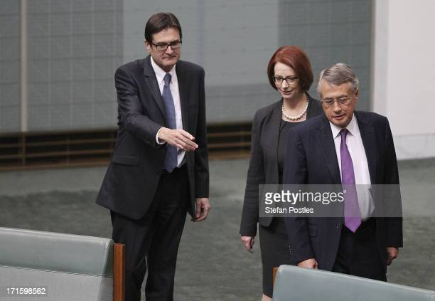 Former PM Julia Gillard is flanked by former ministers Greg Combet and Wayne Swan during House of Representatives question time on June 27 2013 in...