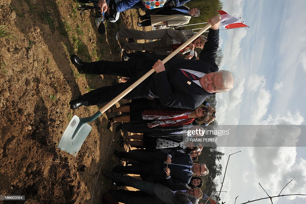 Former Poland president Lech Walesa plants a tree during the commemoration of the 220th anniversary of the outbreak of the royalist rebellion and counterrevolution in Vendee during the French Revolution, on April 18, 2013 in Lucs-sur-Boulogne.