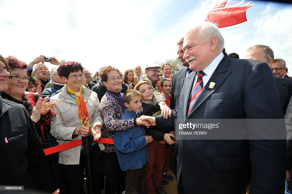 Former Poland president Lech Walesa (R) shakes hands with members of the audience during the commemoration of the 220th anniversary of the outbreak of the royalist rebellion and counterrevolution in Vendee during the French Revolution, on April 18, 2013 in Lucs-sur-Boulogne.
