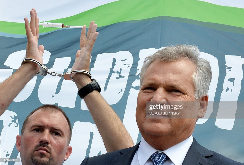 Former Polish President Aleksander Kwasniewski attends on June 26, 2013 the 'Support. Don't Punish' public street event in the center of the Ukrainian capital of Kiev. People who use drugs legally or illegaly, their parents and medical workers protest against cruel and senseless state policies, which severely affect the lives of tens of thousands convicted for possessing a small amount of drug substances for personal use. Protesters called for an end to the blossoming 'drug corruption' in the law enforcement structures. The protest was organized on the occasion of the International Day against Drug Abuse and illicit Trafficking, as well as the International Day in support of Victims of Torture within the framework of the global 'Support. Don't punish' campaign to the held at the same time in 26 capitals and big cities of the world.