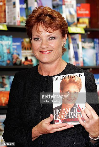 Former politician Pauline Hanson poses with a copy of her new book during a signing of her autobiography 'Untamed Unashamed The Autobiography' at...