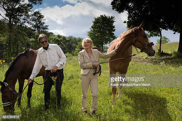 Former porn star and current tv presenter Brigitte Lahaie with husabnd Patrick are photographed at home for Paris Match on July 29 2014 in Versailles...