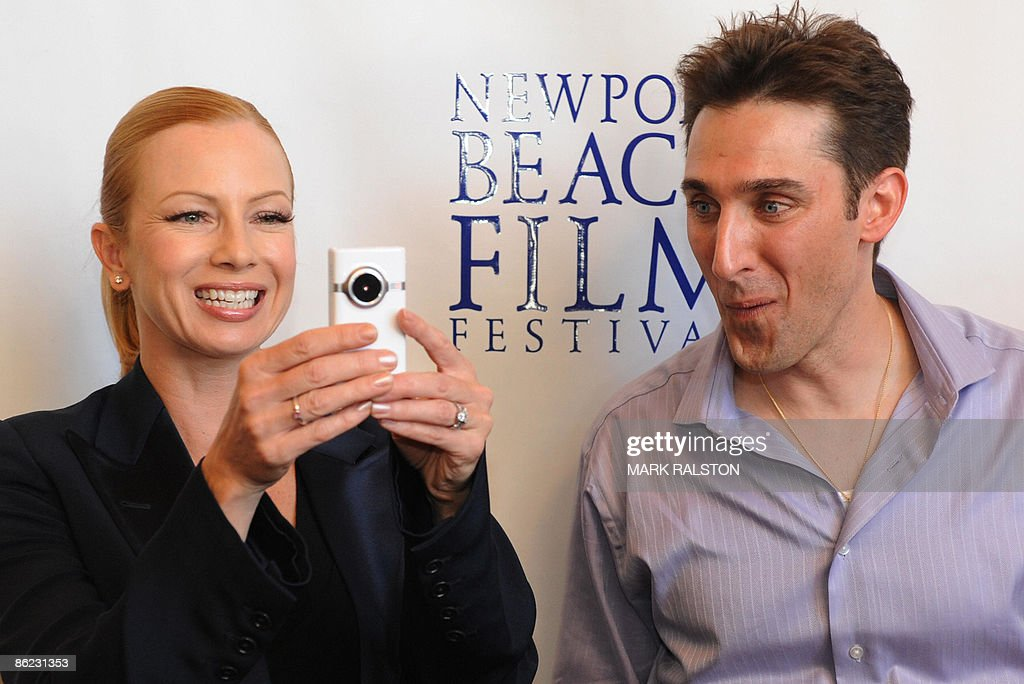 Former porn star turned mainstream actress Traci Lords with Producer/actor Paul Alessi as they arrive for the premiere of the film 'Knuckle Draggers' at the Newport Beach Film Festival in Los Angeles on April 26, 2009. The film takes a realistic, but comic look at how the behaviour of men and women have evolved very little since caveman times. AFP PHOTO/Mark RALSTON