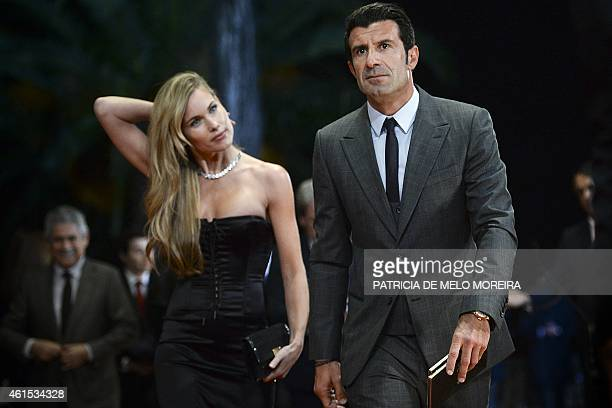 Former Portuguese football player Luis Figo arrives with his wife on the red carpet at the ceremony 'Quinas de Ouro' celebrating the 100th...