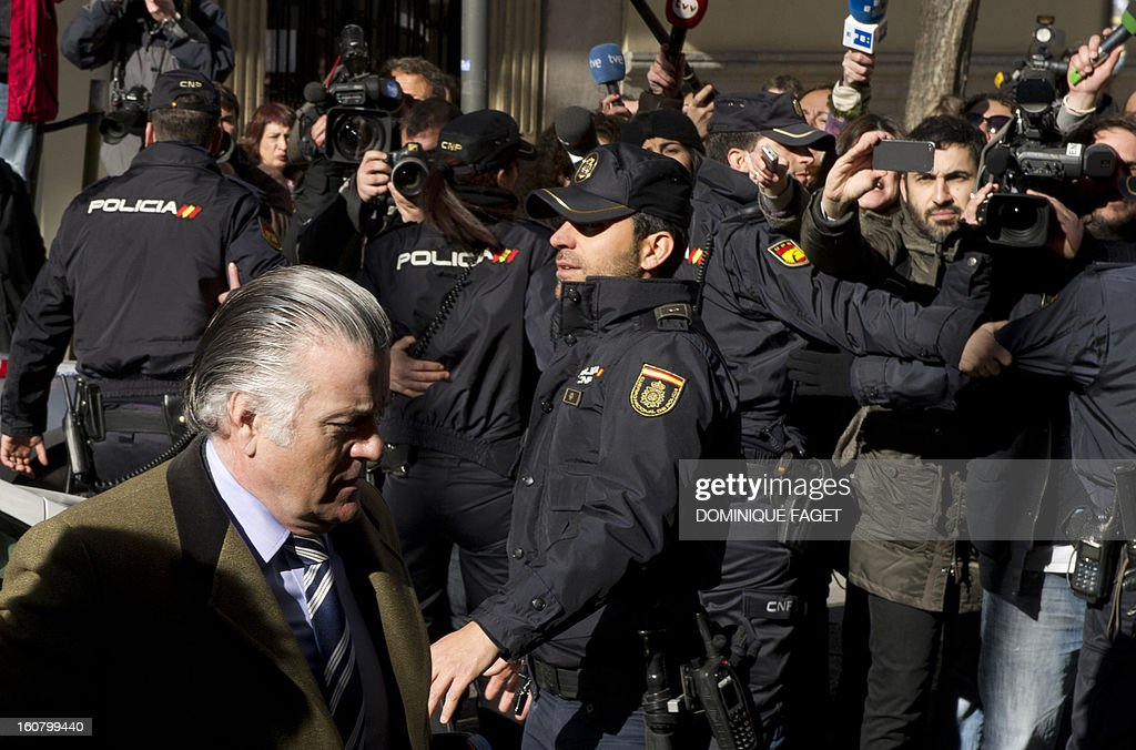 former PP (Popular Party)'s treasurer Luis Barcenas (L) arrives at the anti-corruption prosecuting office in Madrid to be questionned about undeclared salaries's case on February 6, 2013. The centre-right newspaper El Mundo reported in January 2013 that senior Popular Party members collected undeclared salaries, mainly from private companies. Citing 'five reliable sources of successive management boards of the party', the newspaper said former Popular Party treasurer Luis Barcenas distributed envelopes containing 5,000-15,000 euros ($6,500 -20,000) to party officials on top of their official salaries during two decades.