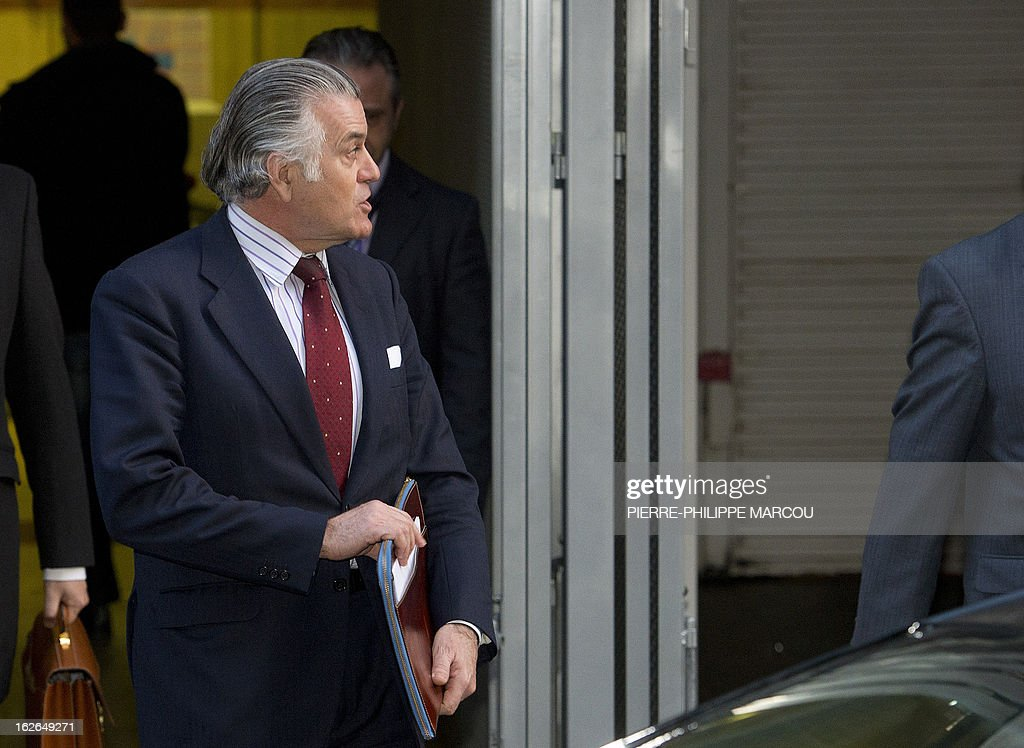 Former PP (Popular Party)'s treasurer Luis Barcenas leaves the National Court in Madrid, after being questioned about the origin of 22 million euros (29 million USD) he amassed in a Swiss bank account, an amount he reportedly concealed from Spanish tax authorities, on February 25, 2013. Barcenas, who served for one year as the right-leaning party's treasurer and 19 as its assistant treasurer, is under investigation following reports that he had stashed up to 22 million euros (29 million USD) in Swiss bank accounts until 2009. AFP PHOTO / PIERRE-PHILIPPE MARCOU