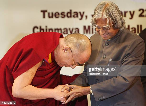 Former President APJ Abdul Kalam gestures to exiled Tibetan spiritual leader the Dalai Lama after addressing the launch of the Global Foundation for...