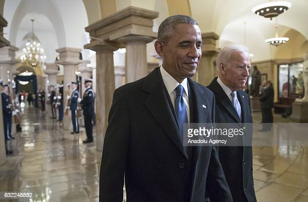 Former President Barack Obama and Former Vice President Joe Biden walk through the Crypt of the Capitol for Donald Trumps inauguration ceremony in...