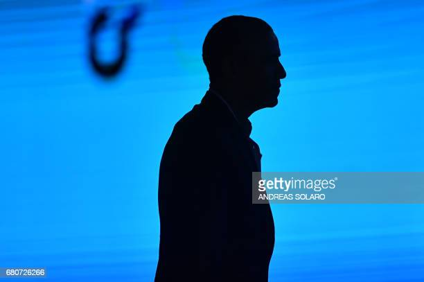 TOPSHOT US former President Barack Obama is silhouetted as he leaves the stage at the end of his speech during the third edition of 'Seed Chips The...