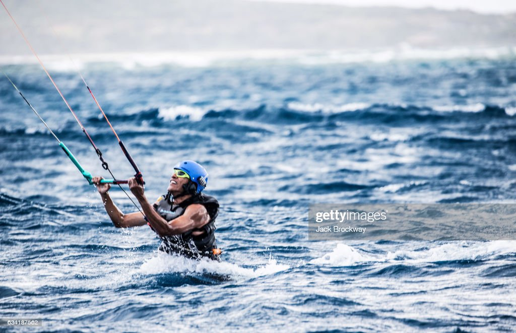 Former President Barack Obama kitesurfs at Richard Branson's Necker Island retreat on January 29, 2017 in the British Virgin Islands. Former President Obama and his wife Michelle have been on an extended vacation since leaving office on January 20.