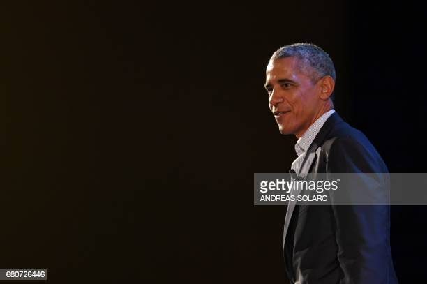 US former President Barack Obama leaves the stage at the end of his speech during the third edition of 'Seed Chips The Global Food Innovation Summit'...