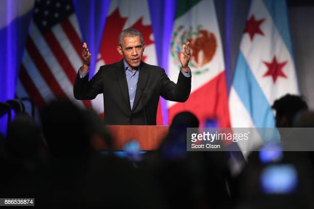 Former president Barack Obama speaks to a gathering of more than 50 mayors and other guests during the North American Climate Summit on December 5...