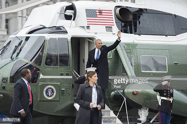 Former President Barack Obama waves as he departs the inauguration on Capitol Hill in Washington DC on January 20 2017 PresidentElect Donald Trump...