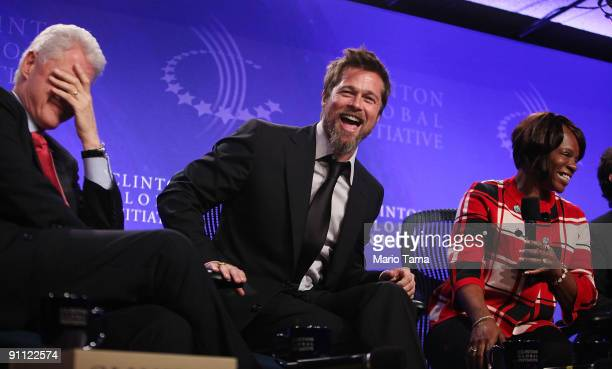 Former President Bill Clinton actor Brad Pitt and Lower Ninth Ward homeowner Deidra Taylor laugh while discussing postKatrina New Orleans at the...