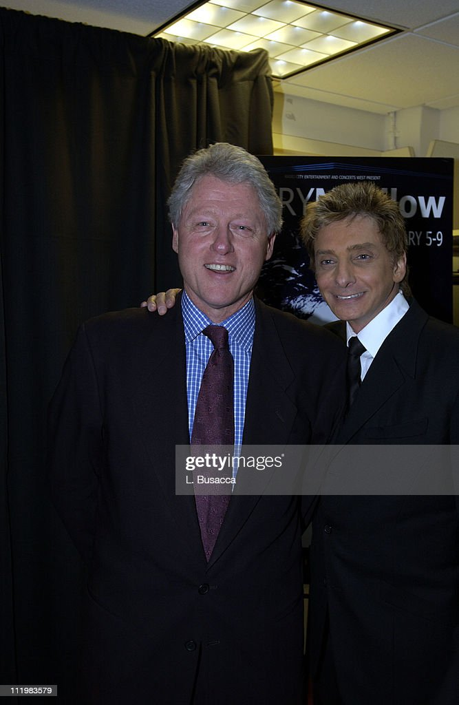 Former president <a gi-track='captionPersonalityLinkClicked' href=/galleries/search?phrase=Bill+Clinton&family=editorial&specificpeople=67203 ng-click='$event.stopPropagation()'>Bill Clinton</a> and <a gi-track='captionPersonalityLinkClicked' href=/galleries/search?phrase=Barry+Manilow&family=editorial&specificpeople=210534 ng-click='$event.stopPropagation()'>Barry Manilow</a> backstage after Manilow's opening night performance at Radio City Music Hall