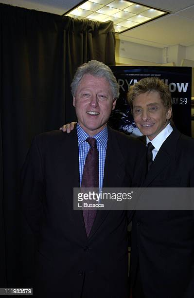 Former president Bill Clinton and Barry Manilow backstage after Manilow's opening night performance at Radio City Music Hall