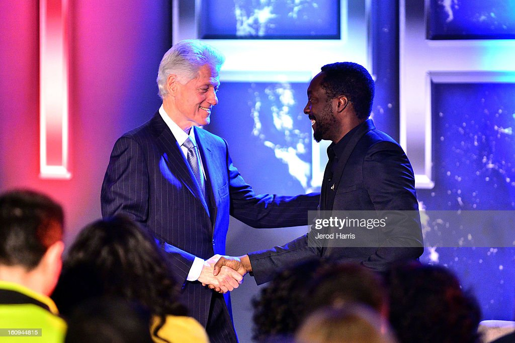 Former President <a gi-track='captionPersonalityLinkClicked' href=/galleries/search?phrase=Bill+Clinton&family=editorial&specificpeople=67203 ng-click='$event.stopPropagation()'>Bill Clinton</a> and will.i.am shake hands at <a gi-track='captionPersonalityLinkClicked' href=/galleries/search?phrase=Will.I.Am&family=editorial&specificpeople=203050 ng-click='$event.stopPropagation()'>Will.I.Am</a>'s Annual TRANS4M Day Conference on TRANS4Ming America on February 7, 2013 in Los Angeles, California.