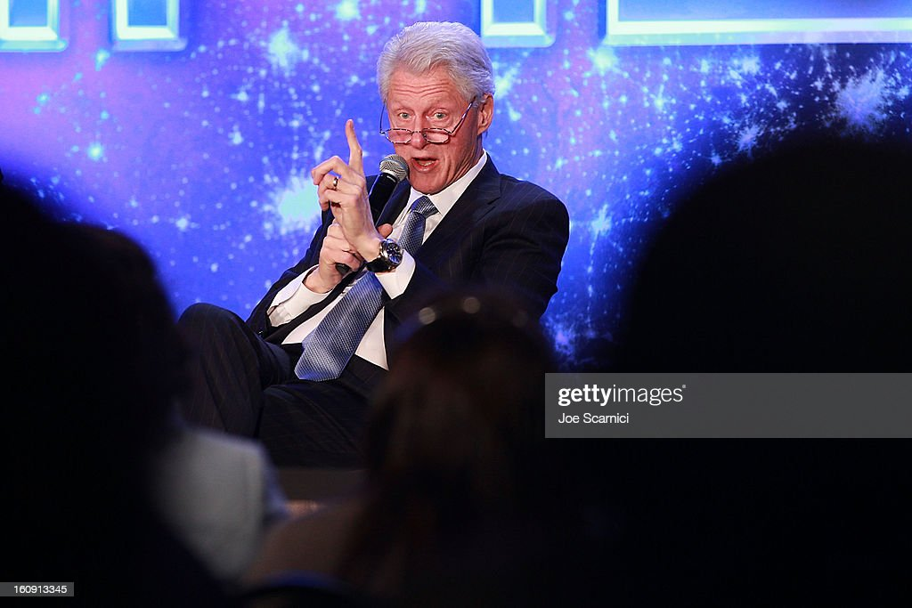 Former President Bill Clinton attends Will.I.Am's annual TRANS4M Day Conference focusing on TRANS4Ming America in 2013 on February 7, 2013 in Los Angeles, California.