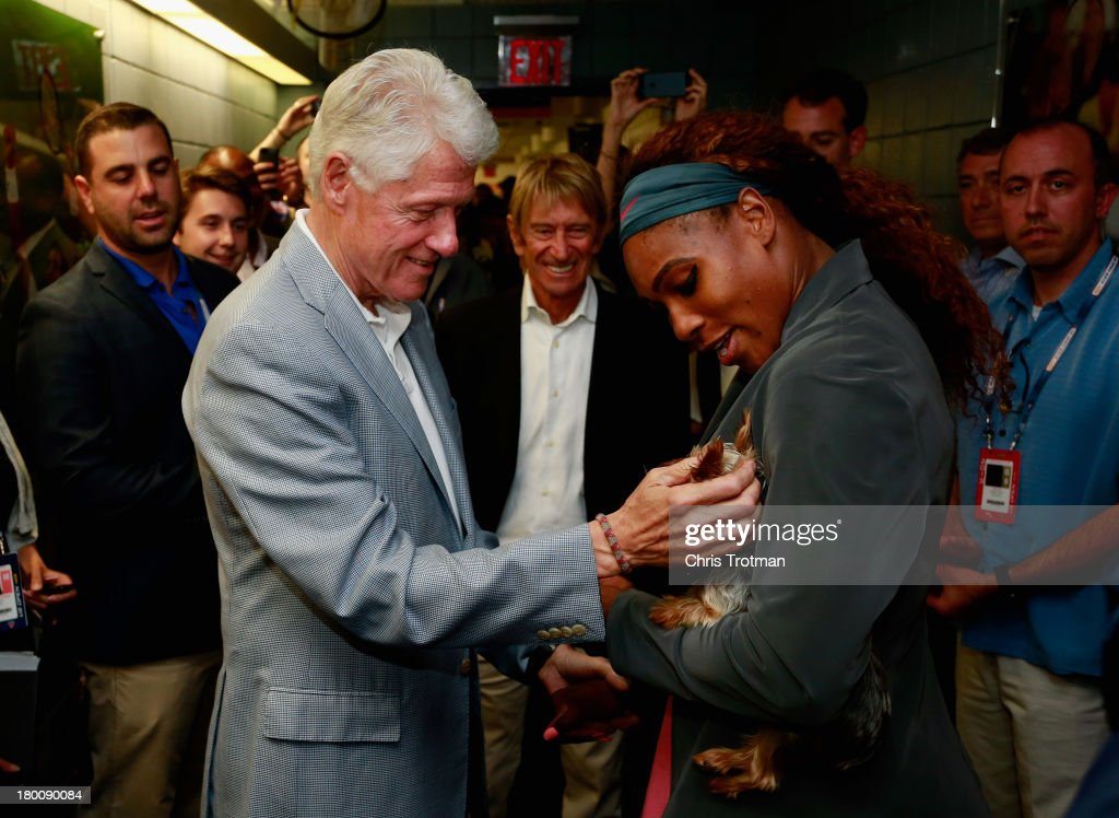 Former President <a gi-track='captionPersonalityLinkClicked' href=/galleries/search?phrase=Bill+Clinton&family=editorial&specificpeople=67203 ng-click='$event.stopPropagation()'>Bill Clinton</a> congratulates <a gi-track='captionPersonalityLinkClicked' href=/galleries/search?phrase=Serena+Williams+-+Tennis+Player&family=editorial&specificpeople=171101 ng-click='$event.stopPropagation()'>Serena Williams</a> of the United States after her women's singles final victory on Day Fourteen of the 2013 US Open at the USTA Billie Jean King National Tennis Center on September 8, 2013 in New York City.