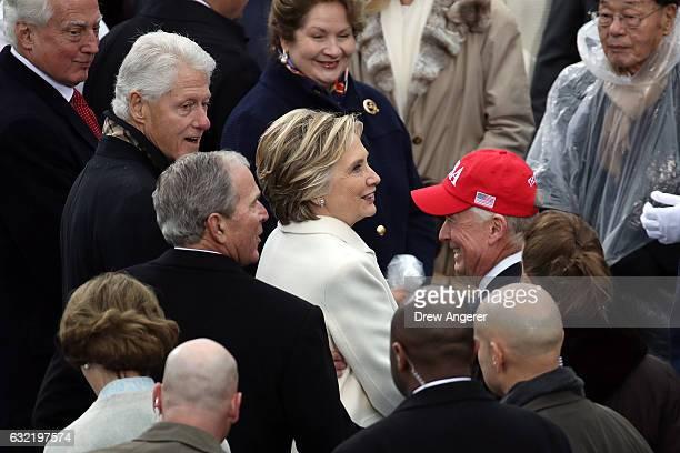 Former President Bill Clinton former President George W Bush former Democratic presidential nominee Hilary Clinton and former Vice President Dan...