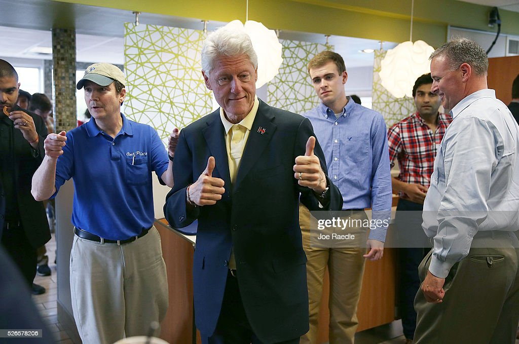 Former President Bill Clinton gives the thumbs up as he stops at the Cone Palace restaurant while campaigning for his wife, Democratic presidential candidate Hillary Clinton, on April 30, 2016 in Kokomo, Indiana. Presidential candidates continue to campaign across the state leading up to Indiana's primary day on Tuesday.