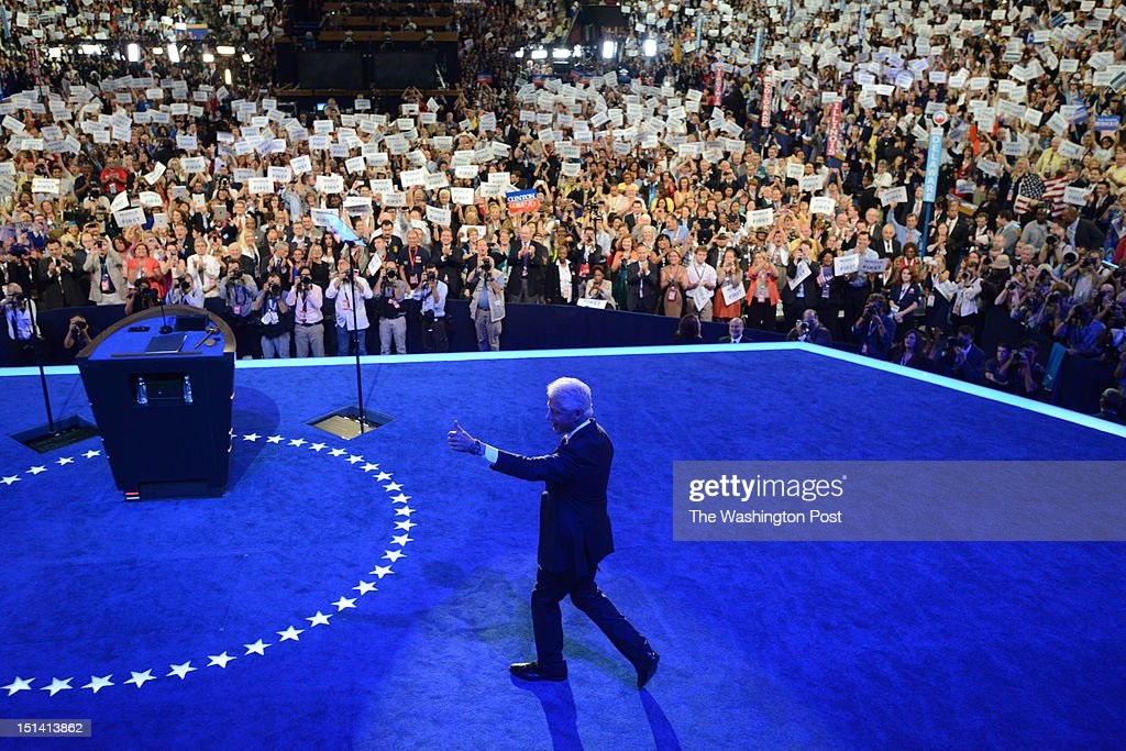 Former President Bill Clinton gives the thumbs up sign as he walks onstage to address the audience during the 2012 Democratic National Convention at...