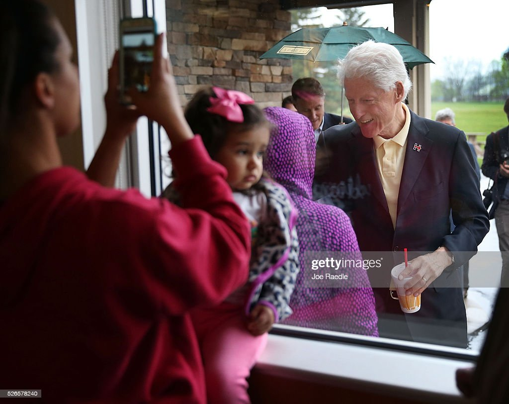 Former President <a gi-track='captionPersonalityLinkClicked' href=/galleries/search?phrase=Bill+Clinton&family=editorial&specificpeople=67203 ng-click='$event.stopPropagation()'>Bill Clinton</a> greets people as he stops at the Cone Palace restaurant as he continues to campaign for his wife, Democratic presidential candidate Hillary Clinton, on April 30, 2016 in Kokomo, Indiana. Presidential candidates continue to campaign across the state leading up to Indiana's primary day on Tuesday.