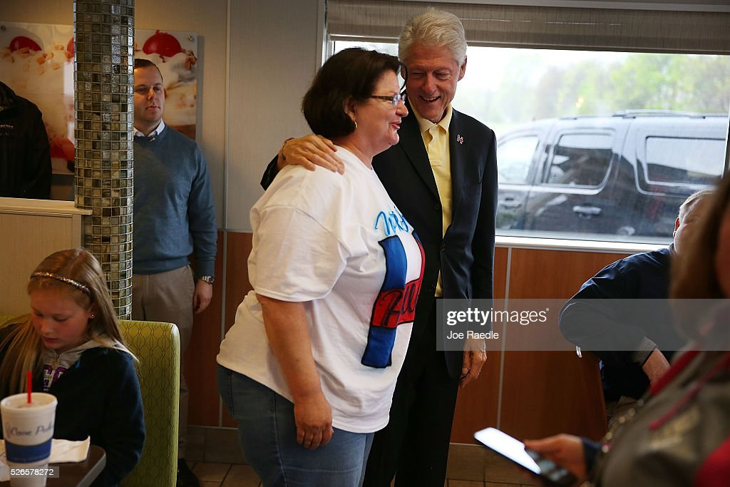 Former President Bill Clinton greets people as he stops at the Cone Palace restaurant as he continues to campaign for his wife, Democratic presidential candidate Hillary Clinton, on April 30, 2016 in Kokomo, Indiana. Presidential candidates continue to campaign across the state leading up to Indiana's primary day on Tuesday.