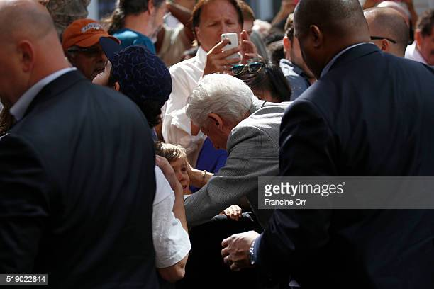 Former President Bill Clinton greets the crowd after stumping for Democratic presidential candidate Hillary Clinton at the Los Angeles Trade...