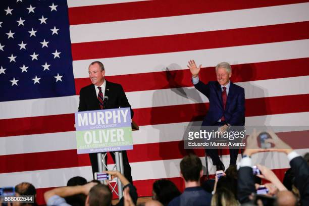 Former president Bill Clinton greets to attendees next to Democratic candidate Phil Murphy who is running for the governor of New Jersey during a...
