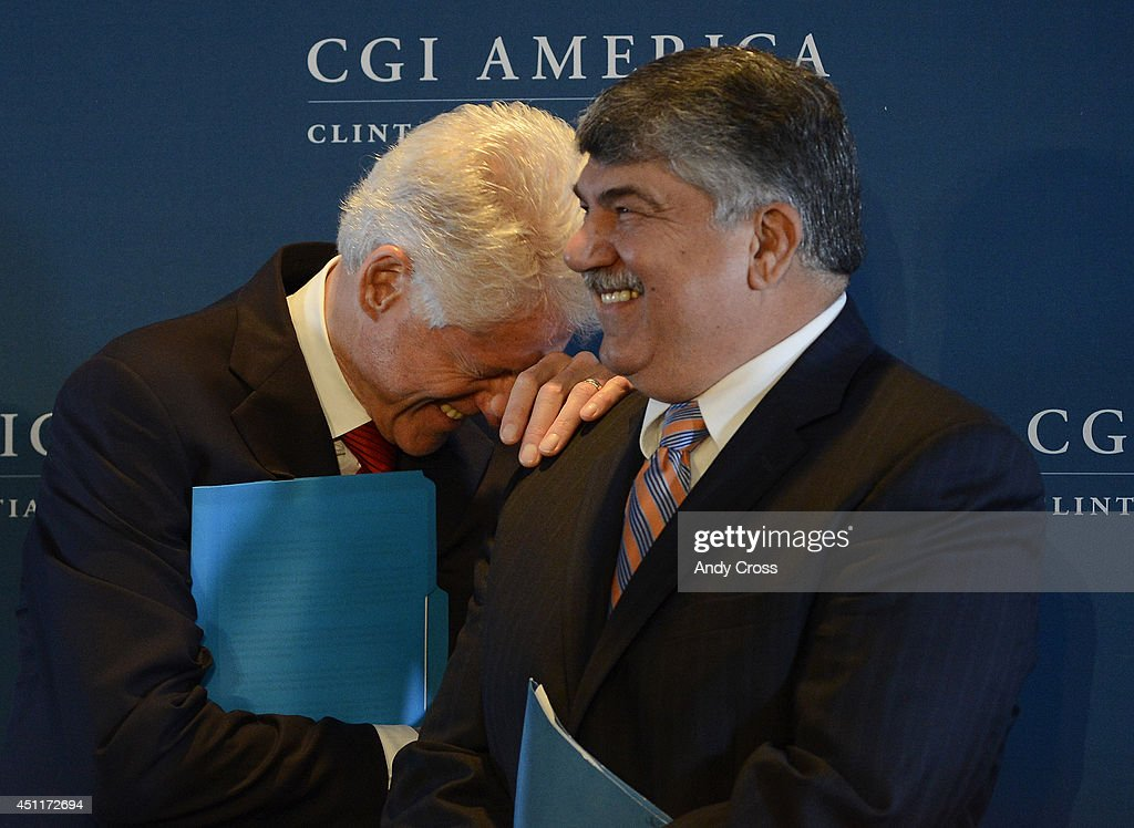 Former President, <a gi-track='captionPersonalityLinkClicked' href=/galleries/search?phrase=Bill+Clinton&family=editorial&specificpeople=67203 ng-click='$event.stopPropagation()'>Bill Clinton</a>, left, has a laugh with <a gi-track='captionPersonalityLinkClicked' href=/galleries/search?phrase=Richard+Trumka&family=editorial&specificpeople=2701507 ng-click='$event.stopPropagation()'>Richard Trumka</a>, President, AFL-CIO during a press conference at the Clinton Global Initiative at the Sheridan Downtown Denver, Tuesday afternoon, June 24, 2014. President Clinton and guests gave an update on a CGI Commitment to Action by the AFL-CIO, to invest $10 billion in infrastructure projects.