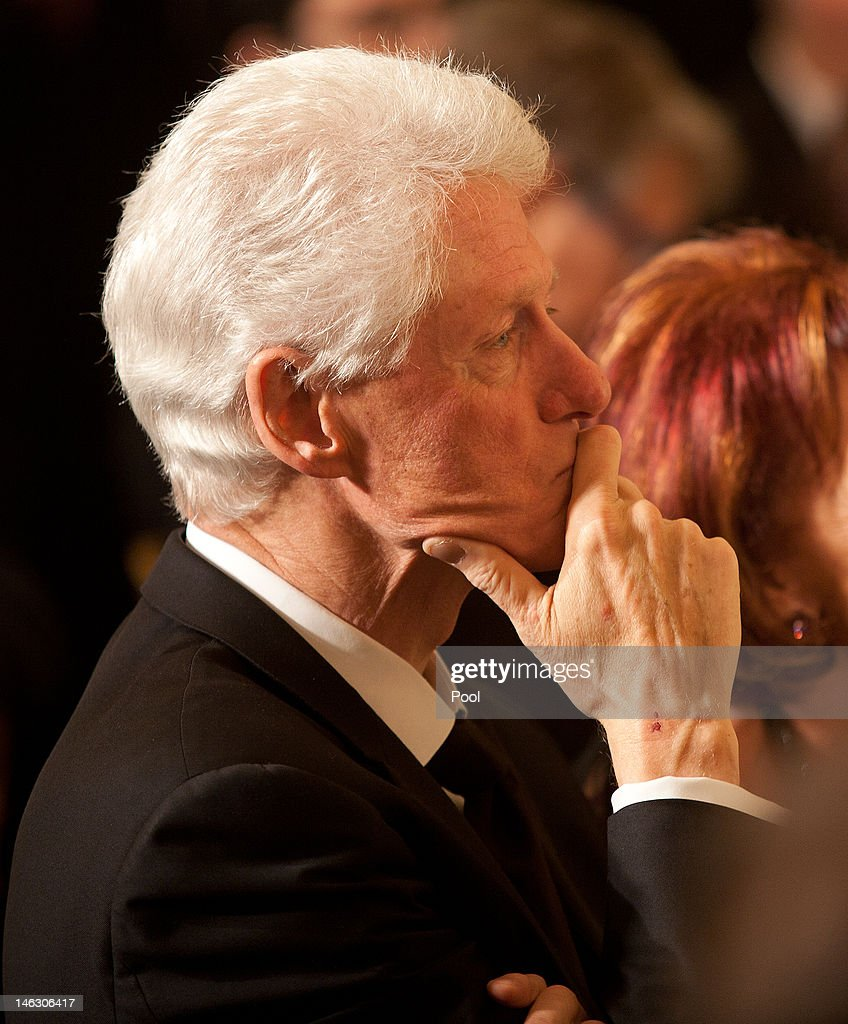 Former President <a gi-track='captionPersonalityLinkClicked' href=/galleries/search?phrase=Bill+Clinton&family=editorial&specificpeople=67203 ng-click='$event.stopPropagation()'>Bill Clinton</a> listens to Israeli President Shimon Peres speak during a dinner in honor of Peres receiving the Presidential Medal of Freedom, in the East Room of the White House, in Washington, on June 13, 2012 in Washington, D.C. Peres is the second Israeli, after Natan Sharansky, to receive the Presidential Medal of Freedom.