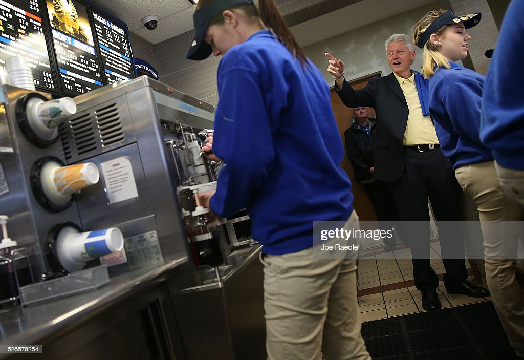 Former President Bill Clinton looks at the menu as he orders items during a stop at the Cone Palace restaurant while campaigning for his wife, Democratic presidential candidate Hillary Clinton, on April 30, 2016 in Kokomo, Indiana. Presidential candidates continue to campaign across the state leading up to Indiana's primary day on Tuesday.