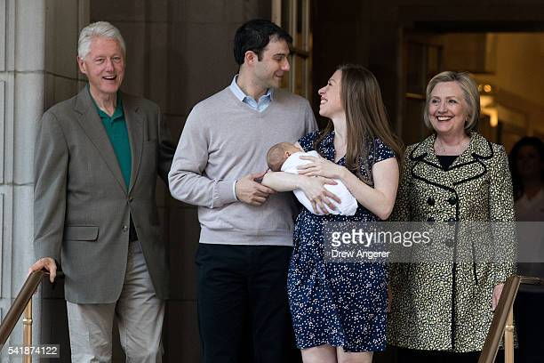 Former President Bill Clinton Marc Mezvinsky Chelsea Clinton holding her newborn son Aidan and Democratic Presidential candidate Hillary Clinton exit...