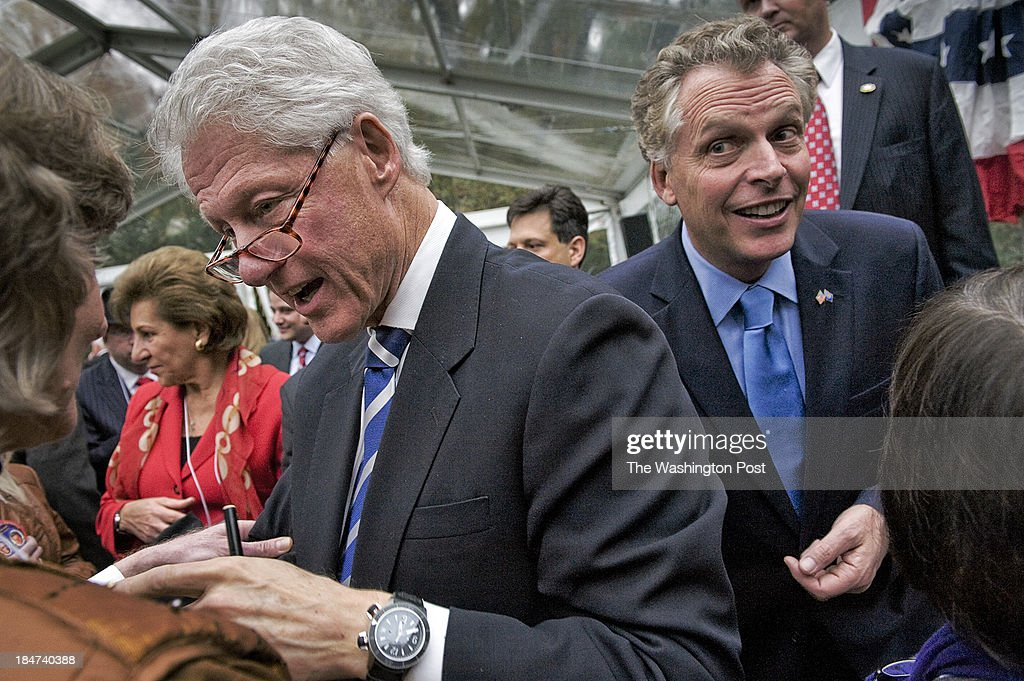 Former President Bill Clinton pays a visit to a fundraiser for state Democrats at the nome of Terry McAuliffe, right, on October, 28, 2011 in McLean, VA.