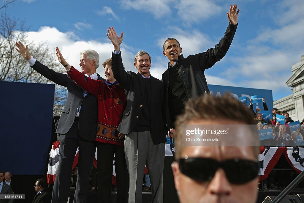 Former President Bill Clinton, Sen. Jeanne Shaheen (D-NH), New Hampshire Gov. John Lynch and U.S. President Barack Obama wave to supporters at the end of a campaign rally in State Capitol Square November 4, 2012 in Concord, New Hampshire. With only two days left until the presidential election, Obama and his opponent, former Massachusetts Gov. Mitt Romney are stumping from one 'swing state' to the next in a last-minute rush to persuade undecided voters.