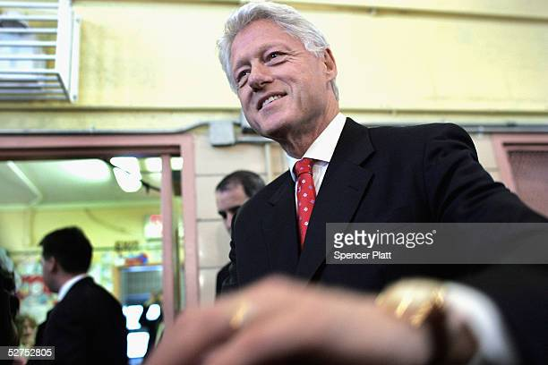 Former President Bill Clinton shakes hands at a public school May 3 2005 in New York City Calling it a national epidemic Clinton and Arkansas Gov...