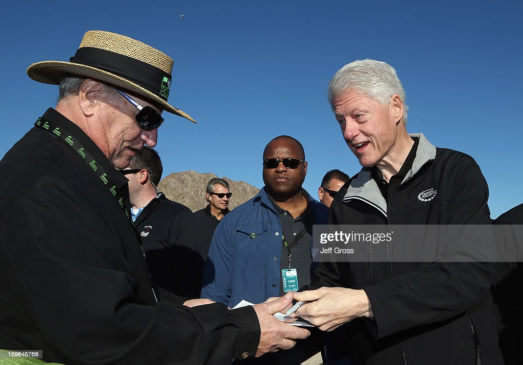 Former President, <a gi-track='captionPersonalityLinkClicked' href=/galleries/search?phrase=Bill+Clinton&family=editorial&specificpeople=67203 ng-click='$event.stopPropagation()'>Bill Clinton</a>, signs an autograph for a fan prior to the start of the first round of the Humana Challenge In Partnership With The Clinton Foundationat at the Palmer Private Course at PGA West on January 17, 2013 in La Quinta, California.