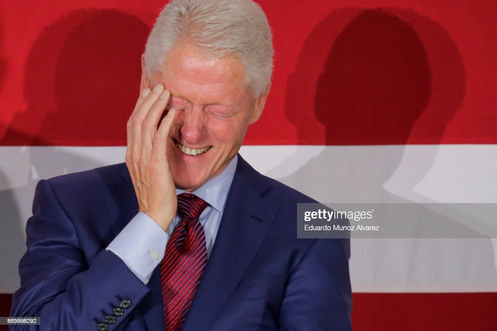 Former president Bill Clinton smiles as Democratic candidate Phil Murphy, who is running for the governor of New Jersey speaks about New Jersey governor Chris Christie during a rally on October 24, 2017 in Paramus, New Jersey. The gubernatorial election of 2017 will take place on November 7, where Democratic candidate Phil Murphy and Republican Lt. Gov. Kim Guadagno lead the polls in the race to succeed Chris Christie as New Jersey's governor.