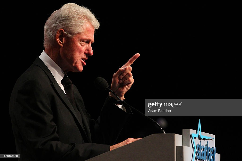 Former President <a gi-track='captionPersonalityLinkClicked' href=/galleries/search?phrase=Bill+Clinton&family=editorial&specificpeople=67203 ng-click='$event.stopPropagation()'>Bill Clinton</a> speaks during the 2013 Starkey Hearing Foundation's 'So the World May Hear' Awards Gala on July 28, 2013 in St. Paul, Minnesota.