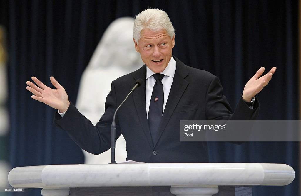 Former President Bill Clinton speaks during the funeral service for Sargent Shriver at Our Lady of Mercy Catholic Church January 22 2011 in Potomac...