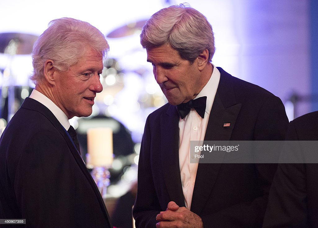 Former President Bill Clinton (L) talks to Secretary of State John Kerry during a dinner for Medal of Freedom awardees at the Smithsonian National Museum of American History on November 20, 2013 in Washington, DC. The Presidential Medal of Freedom is the nation's highest civilian honor, presented to individuals who have made meritorious contributions to the security or national interests of the United States, to world peace, or to cultural or other significant public or private endeavors.