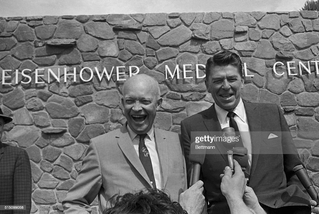 Former President Dwight D. Eisenhower and California Governor Ronald Reagan exchange quips outside the Eisenhower Medical Center before a lunch meeting.