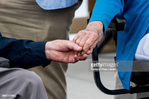 Former President George H W Bush and first lady Barbara Bush hold hands during the dedication ceremony for the Mathew J Lanigan bridge connecting...