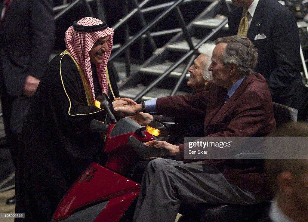 Former President George H W Bush and first lady Barbara Bush shake hands with His Excellency the Deputy Prime Minister of the State of Kuwait Sheikh...