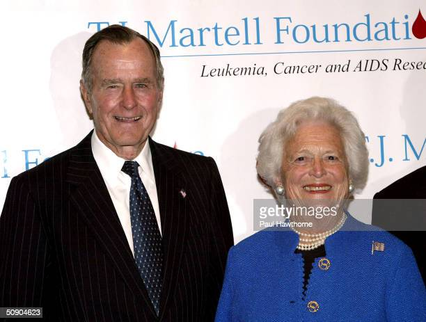 Former President George H W Bush and his wife Barbara pose for photographers before the start of the 29th Annual TJ Martell Foundation Awards Gala at...