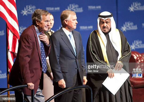 Former President George H W Bush stands with former Vice President Dan Quayle and a representative of the envoy of His Royal Highness Sheikh Sabah...